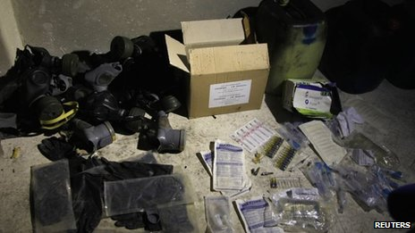 Chemical materials and gas masks purportedly found by Syrian government forces at a warehouse in Jobar, Damascus (24 August 2013)