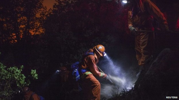 Firefighters dig on a steep incline to combat the Rim Fire in California on 25 August 2013