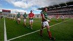 The Mayo and Tyrone teams parade before the All-Ireland Football Championship semi-final at Croke Park in Dublin