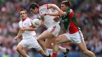 Tyrone midfielder Sean Cavanagh of Tyrone attempts to evade the challenge by Mayo's Seamus O'Shea at Croke Park