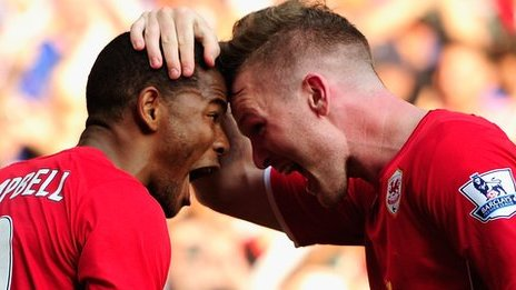 Fraizer Campbell and Aron Gunnarsson celebrate after the third Cardiff goal