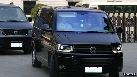 A minivan believed to be carrying disgraced Chinese politician Bo Xilai leaves the Jinan Intermediate People's Court after the end of the fifth day of Bo's trial in Jinan, Shandong province, 26 August 2013