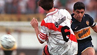 Boca Juniors playmaker Diego Maradona (right) takes on Eduardo Berizo of River Plate in a Superclassico in 1997