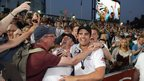 Kevin Pietersen and Alastair Cook continue their celebrations into the jubilant Oval crowd.