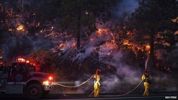Firefighters work to prevent the Rim Fire near Buck Meadows, California, on 24 August 2013