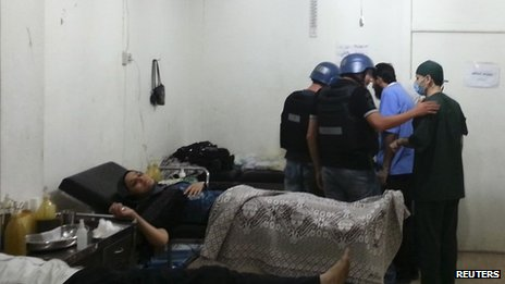 UN experts visit a hospital at the site of an alleged chemical weapons attack near Damascus, 26 August 2013