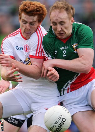 Peter Harte of Tyrone collides with Mayo's Tom Cunniffe