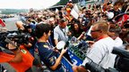 Mark Webber signs autograph for fans