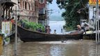 Boat in flooded street in India