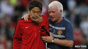 Manchester United's Shinji Kagawa and first-team coach Jimmy Lumsden