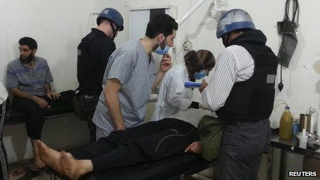 UN chemical weapons experts visit people affected by an apparent gas attack at a hospital in the south-western Damascus suburb of Mouadamiya on 26 August 2013
