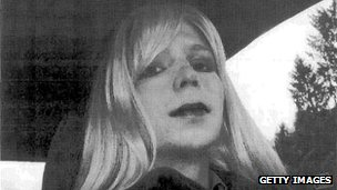 In this undated photo provided by the US Army, Pte Bradley Manning wears a wig while sitting in a car.
