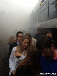 Passengers evacuating the train