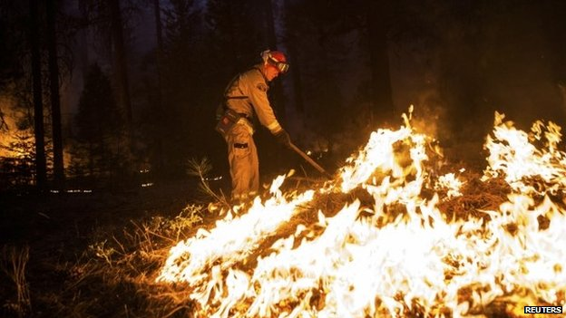 A firefighter battles California's Rim Fire near Yosemite National Park on 26 August 2013