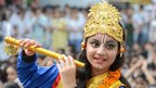 An Indian pupil dressed as the Hindu god Krishna poses on the eve of the Janmashtami festival at a school in Amritsar