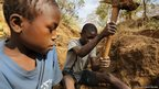 Two 13-year-old boys dig for gold ore at a small-scale mine in Mbeya Region, Tanzania. © 2013 Justin Purefoy for Human Rights Watch