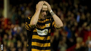 Alloa defender Michael Doyle is left devastated by his penalty miss