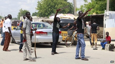 "Vigilantes from the ""Civilian Joint Task Force"" group man a checkpoint in Maiduguri, Nigeria armed with with cutlasses and clubs on 7 August 2013 (file image)"