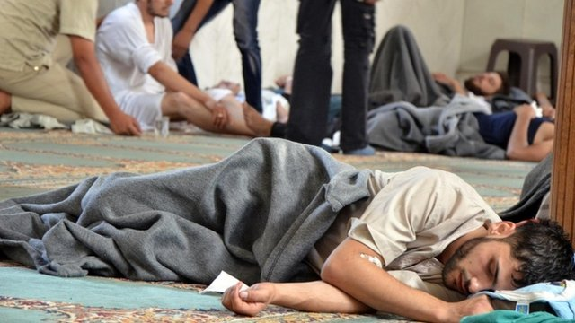 A survivor from what activists say is a gas attack rests inside a mosque in the Duma neighbourhood of Damascus (21 August 2013)