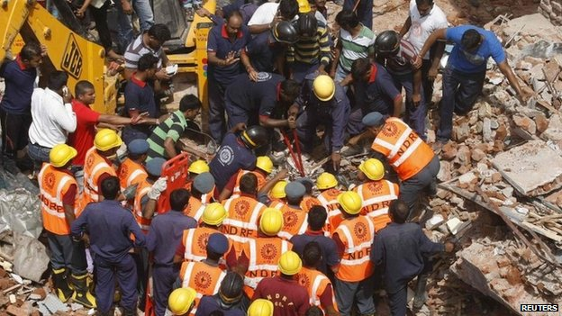 Rescue workers during a search operation for survivors in Vadodara in the western Indian state of Gujarat August 28, 2013