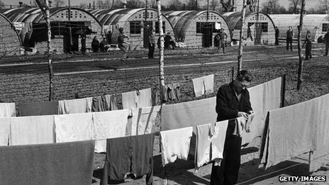 A German POW hangs out washing at the camp in 1947