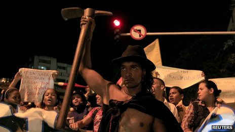 A man takes part in a demonstration in support of striking farmers in Cali on 26 August 2013