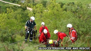 Fire crews rescue a paraglider who had crashed into a cliff