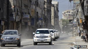 UN weapons inspectors drive alongside Free Syrian Army vehicle