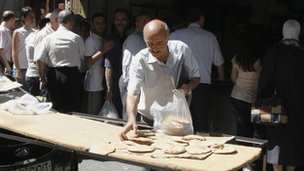syrians queuing for bread