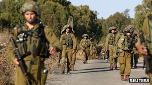 Israeli soldiers take part in a drill in the Israeli-occupied Golan Heights on 18 August 2013.
