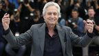 US actor Michael Douglas poses on May 21, 2013 during a photocall for the film Behind the Candelabra at the Cannes Film Festival in Cannes.