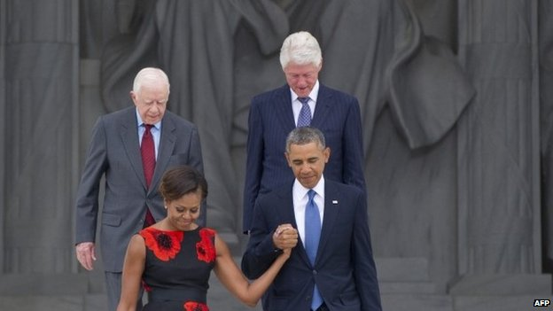 US President Barack Obama and First Lady Michelle Obama, along with former US President Bill Clinton and Jimmy Carter at the Lincoln Memorial in Washington DC on 28 August 2013