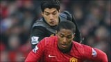 Luis Suarez and Antonio Valencia