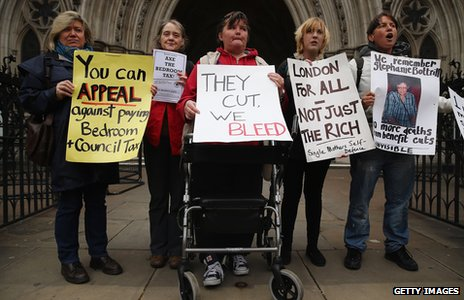 Protesters against the bedroom tax stand outside the High Court