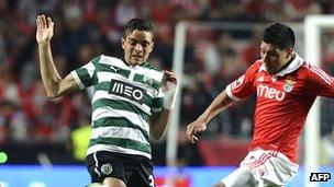 Tiago Ilori (left) challenges Benfica's Enzo Perez