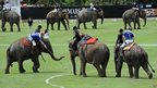 Players compete during the annual elephant polo tournament in the seaside resort of Hua Hin south of Bangkok