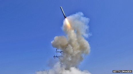 The US Navy guided-missile destroyer USS Barry (DDG 52) launches a Tomahawk cruise missile in support of Operation Odyssey Dawn on 29 March 2011 from the Mediterranean Sea