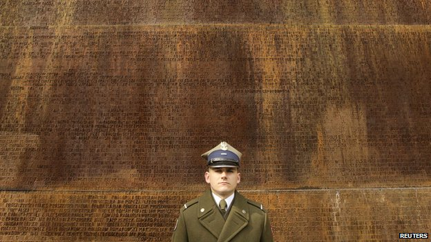 Soldier at memorial to the Katyn Massacre victims