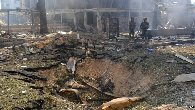 Lebanese army soldiers stand next to a blast crater outside of a mosque, in the northern city of Tripoli, Lebanon, Friday 23 August, 2013.
