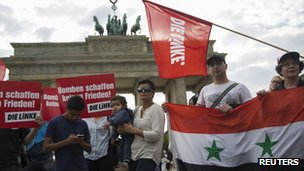 Supporters of the left-wing Die Linke party protest in front of Brandenburg Gate in Berlin against possible Western military action in Syria on 27 August 2013