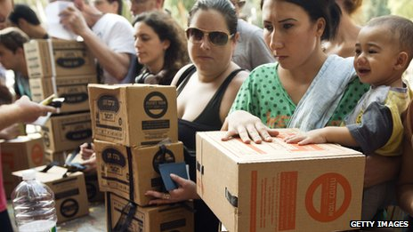 Israelis queue to collect gas mask kits at a distribution centre in the Mediterranean coastal city of Haifa, north of Israel, on August 29, 2013