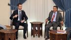 A handout picture released by the Sana news agency on August 29, 2013 shows Syrian President Bashar al-Assad (l) meeting a Yemeni delegate in Damascus