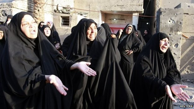 Women mourn during the funeral of a victim who was killed during bombings in Baghdad 29 August, 2013.