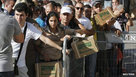 queue in Haifa of Israelis waiting for gas masks