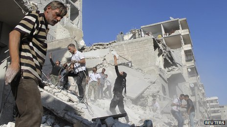 "Men search for survivors amid rubbles of collapsed building after what activists said was shelling by forces loyal to Syria""s President Bashar al-Assad in Aleppo""s Fardous neighborhood August 26, 2013"