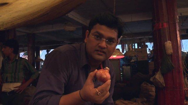 BBC's Nitin Srivastava holding onion