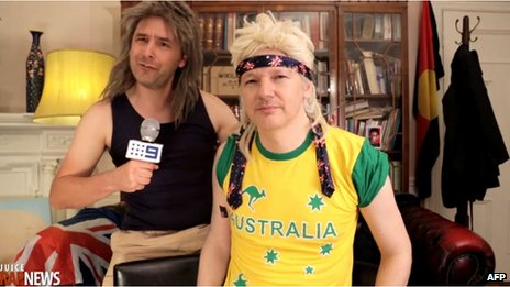 This screen grab taken on 27 August 2013 from video received from www.thejuicemedia.com in Australia shows Wikileaks founder Julian Assange, right, taking part in a musical spoof on his Australian political party for cult web series Rap News