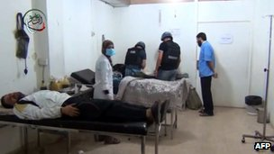 An image grab taken from a video uploaded on YouTube on August 26, 2013 allegedly shows a UN inspectors visiting a hospital in the Damascus suburb of Moadamiyet al-Sham