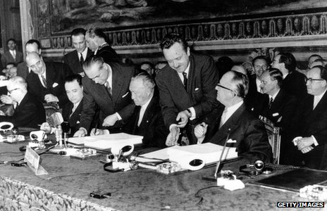 1957 - delegation members sign the Treaty of Rome