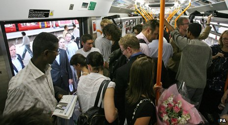 Commuters on overcrowded train